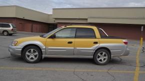 Rarezas circulando 10: Subaru Baja amarilla2003.
